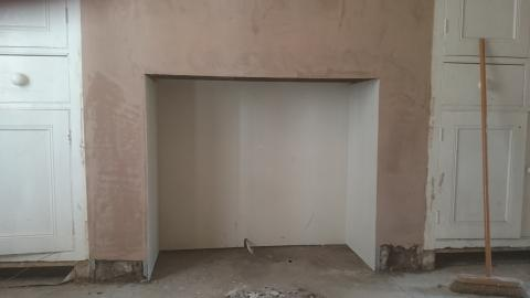 Fireplace dry lined ready for wood burner. | Carlisle Plastering